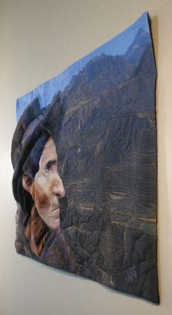 Angled view of fiber art quilt